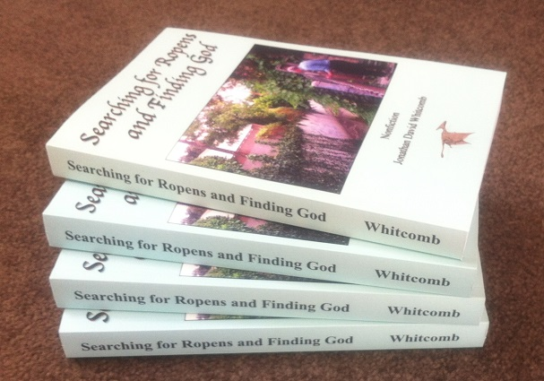 "four copies of Whitcomb's nonfiction cryptozoology true-life adventure ""Searching for Ropens and Finding God"""