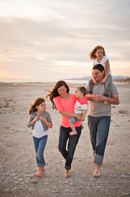 A young family having fun at a beach