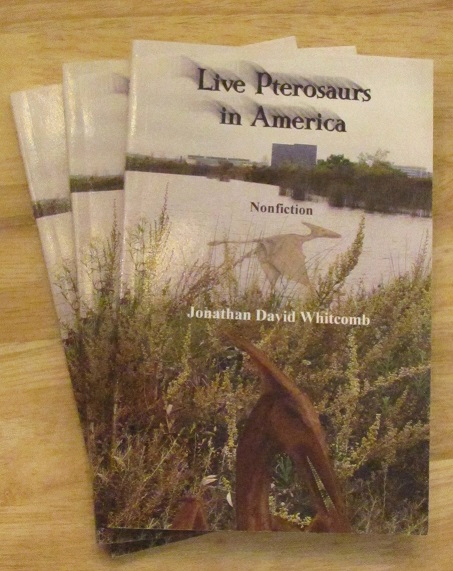 "small pile of copies of the cryptozoology book ""Live Pterosaurs in America"""