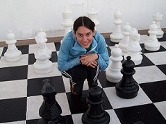 huge chess set with girl on a square