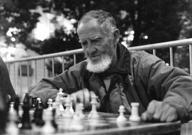 chess played by a man with a beard